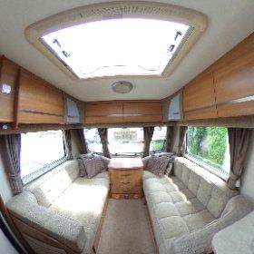 Coachman Laser 640 2011 living room 360 photo. https://www.pirancaravansales.co.uk/303-coachman-laser-640-4