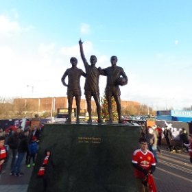 THE UNITED TRINITY: Manchester United legends George Best, Denis Law & Sir Bobby Charlton statue facing one of Sir Matt Busby at front of Old Trafford stadium. #theta360 #theta360uk