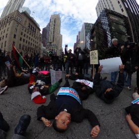 Protesters conduct a die in at Ontario and Michigan calling for Rahm's resignation