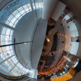 """The Chase Center's wide concourses offer sweeping views of the city and the Bay. Here on the upper level, grab a hot dog and gaze across the water to the Port of Oakland. Below, the silver """"Seeing Spheres"""" sculpture is quickly becoming an Instagram magnet."""
