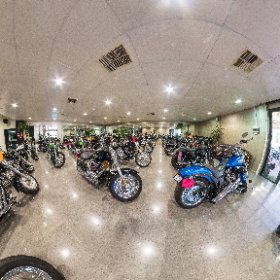 A test image from Kim Britton Motorcycles for camera and photographer reflection removal