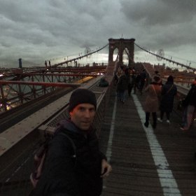 Crossing the iconic Brooklyn Bridge....