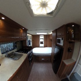 Buccaneer Cruiser 2015 - a very high spec twin axle caravan, with fixed transverse bed and all the bells and whistles! - Living room and kitchen