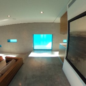 A preview of the stunning Greenbaum House. The swimming pool's cool blue light shines through glass in the desert home's living space.  #theta360
