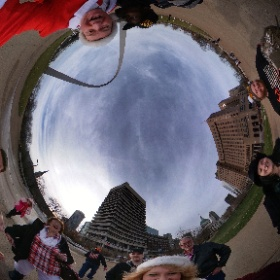 """Everybody loves """"Dapper Santa."""" (sometimes with surprising enthusiasm.) We're on our way to the top of the arch, pausing to take an awesome group photo. @gatewayarchnps @stlouisblues #iceskating #santa #stlouis #christmas #merrychristmas #theta360"""